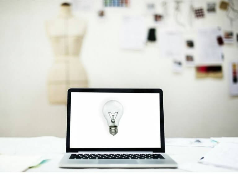 The-Power-up-report-May 2019-issue-118-CaribMedia-Aruba-newsletter-new-business-and-marketing-tips-image -f-laptop-with-lightbulb-onscreen-to-show-innovation-and-inspiration